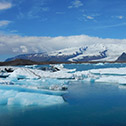 The Jokulsarlon glacier lagoon with the huge Vatnajokull ice cap behind