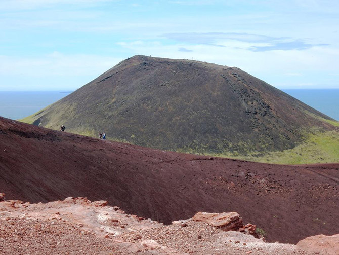 The volcano Helgafell and the rim of Eldfell on Heimaey Island, site of the 1973 eruption