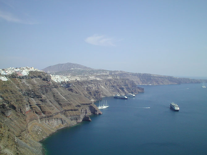 The main island town of Fira nestling above the caldera wall
