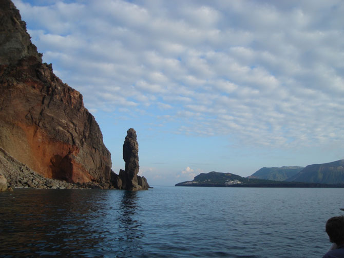 A coastal stack and cliffs in volcanic rocks on the south-western tip of Lipari island