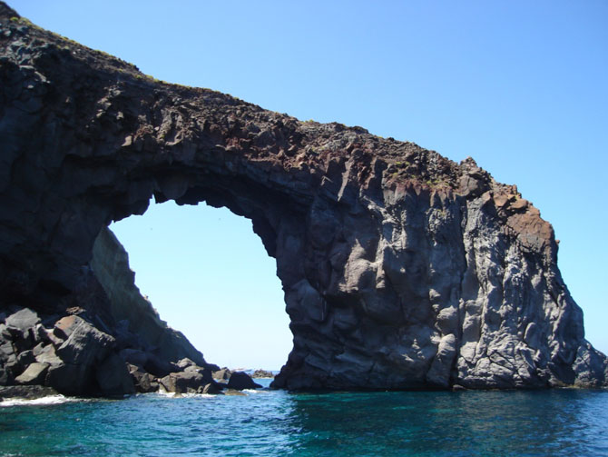 Coastal arch in volcanic rocks on the island of Salina